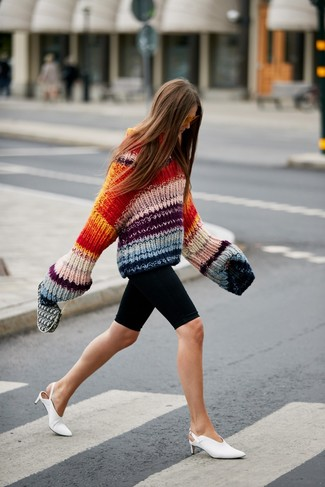 How to wear: orange sunglasses, white leather mules, black bike shorts, multi colored knit oversized sweater
