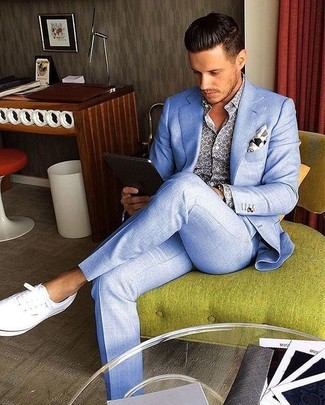How to wear: white print pocket square, white plimsolls, blue print long sleeve shirt, light blue suit