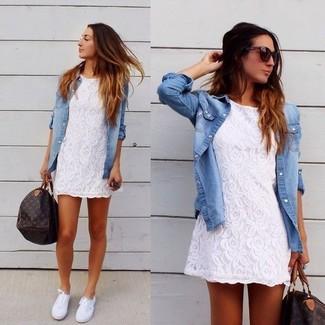 How to wear: dark brown print leather duffle bag, white plimsolls, light blue denim shirt, white lace casual dress