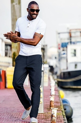 Idris Elba wearing White Polo, Navy Chinos, Grey Canvas Slip-on Sneakers, Black Sunglasses