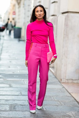 How to wear: hot pink leather clutch, white leather pumps, hot pink dress pants, hot pink turtleneck