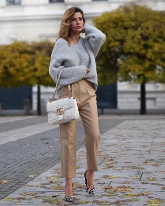 How to wear: white quilted leather satchel bag, white leopard suede pumps, khaki dress pants, grey oversized sweater