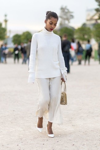 How to wear: beige snake leather handbag, white leather pumps, white wide leg pants, white knit turtleneck