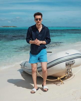 How to wear: black sunglasses, white rubber sandals, aquamarine shorts, navy linen long sleeve shirt