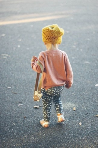 How to wear: yellow beanie, white sandals, black leggings, pink sweater