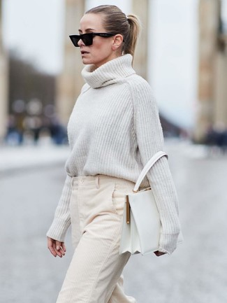 How to wear: black sunglasses, white leather satchel bag, beige corduroy wide leg pants, white knit wool turtleneck