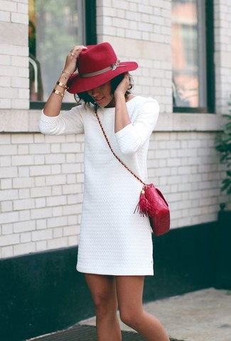 A white textured shift dress and a hat are both versatile essentials that will give your outfits a subtle modification. So when spring is in full effect, you'll find this combo to be your everything.