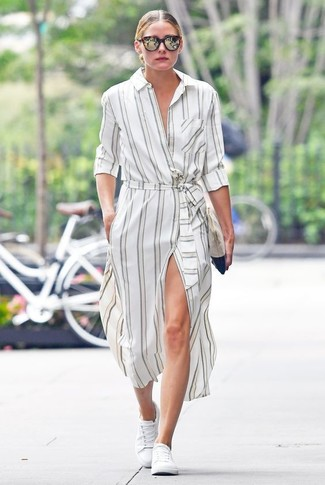 Olivia Palermo wearing White Vertical Striped Shirtdress, White Low Top Sneakers, Beige Suede Clutch, Dark Brown Sunglasses
