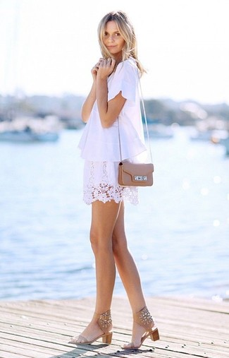 Consider teaming a white short sleeve blouse with a white lace mini skirt to bring out the stylish in you. Go for a pair of camel embellished leather flat sandals for a more relaxed feel.