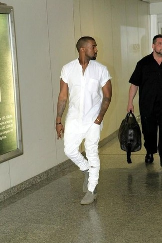 Kanye West wearing White Short Sleeve Shirt, White Ripped Skinny Jeans, Grey Suede Chelsea Boots