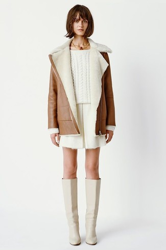 How to wear: beige leather knee high boots, white shorts, white cable sweater, brown shearling coat
