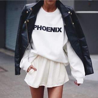 How to Wear a White Skater Skirt: Why not opt for a black leather biker jacket and a white skater skirt? Both of these pieces are very comfortable and look wonderful when combined together.