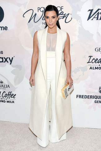 Kim Kardashian wearing White Sleeveless Coat, White Mesh Tank, White Wide Leg Pants, White Embroidered Clutch