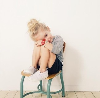 How to Wear a Grey Sweater For Girls: Suggest that your child pair a grey sweater with black shorts for a cool, fashionable look. White sneakers are a wonderful choice to complement this outfit.