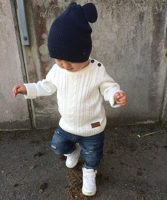 How to wear: navy beanie, white sneakers, blue ripped jeans, white sweater