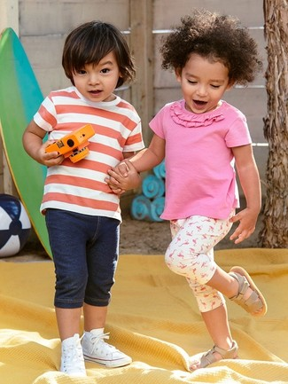 Boys' Looks & Outfits: What To Wear In a Relaxed Way: Suggest that your darling wear a red and white horizontal striped t-shirt with navy denim shorts for a fun day out at the playground. As far as footwear is concerned, let your tot go for a pair of white sneakers.