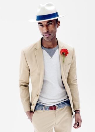 How to wear: white straw hat, grey crew-neck sweater, beige suit