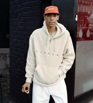 How to wear: red baseball cap, white sweatpants, beige crew-neck t-shirt, beige fleece hoodie