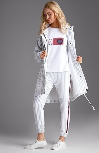How to Wear a White Windbreaker For Women: For To create a casual ensemble with a twist, dress in a white windbreaker and white vertical striped sweatpants. Make a bit more effort with shoes and complement your ensemble with white leather low top sneakers.