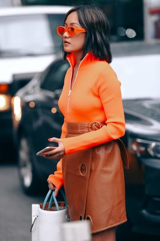 How to wear: orange sunglasses, white leather tote bag, tobacco leather pencil skirt, orange zip neck sweater