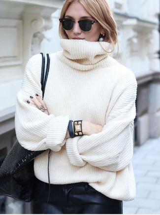 How to wear: white knit turtleneck, black leather sweatpants, black leather tote bag, black studded leather bracelet
