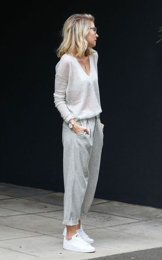 How to wear: white v-neck sweater, grey tapered pants, white low top sneakers, gold watch