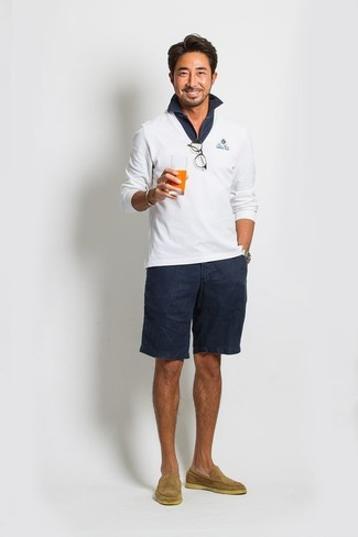 How to wear: white v-neck sweater, navy polo, navy shorts, tan suede loafers