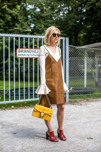 How to wear: white v-neck sweater, tan leather cami dress, burgundy leather mules, yellow suede satchel bag