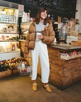 How to wear: tan suede mules, white wide leg pants, grey crew-neck sweater, brown puffer jacket