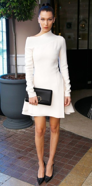 Choose a white wool sheath dress to achieve a neat and proper look. Round off this getup with Rochas Lace Pumps With Front Bow. We're loving this one, especially for springtime.