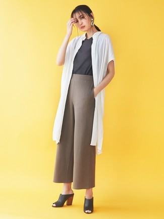How to wear: black leather mules, brown knit wide leg pants, charcoal crew-neck t-shirt, white duster coat