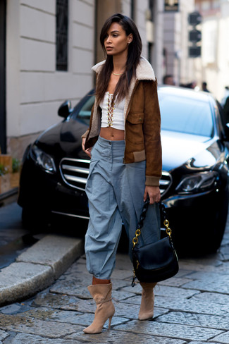 How to wear: tan suede ankle boots, light blue wide leg pants, white cropped top, brown shearling jacket