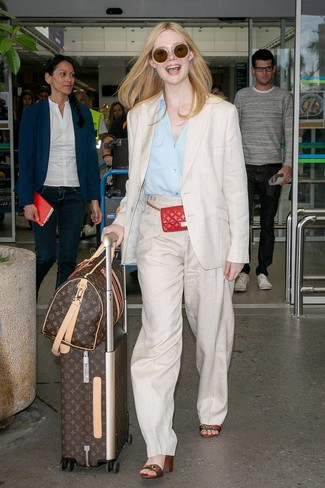 How to Wear Beige Linen Wide Leg Pants: Teaming a beige linen blazer and beige linen wide leg pants is a surefire way to inject your current outfit choices with some glamour. Multi colored horizontal striped leather heeled sandals pull the outfit together.