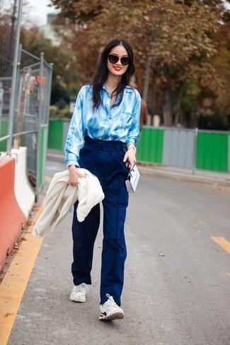 How to wear: white athletic shoes, navy wide leg pants, light blue tie-dye dress shirt, white fleece bomber jacket