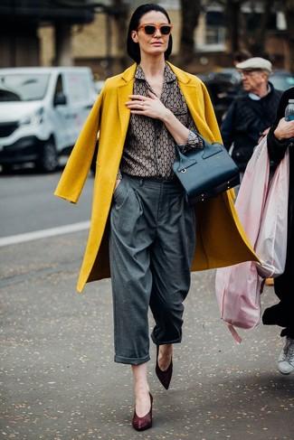 How to wear: burgundy leather pumps, grey wide leg pants, grey print dress shirt, mustard coat