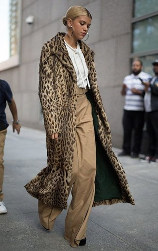 How to wear: black chunky suede pumps, tan wide leg pants, white hoodie, tan leopard fur coat
