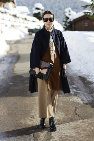 How to wear: black leather ankle boots, tan wide leg pants, brown oversized sweater, navy coat
