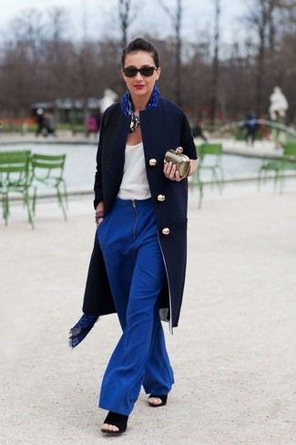 How to wear: black suede heeled sandals, blue wide leg pants, white tank, navy coat