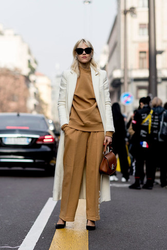 How to wear: black suede pumps, tan wide leg pants, tan turtleneck, white coat