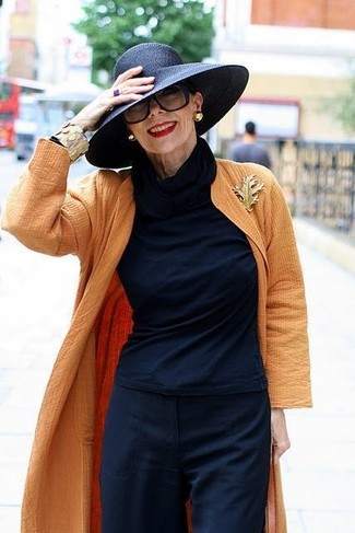 How to Wear a Gold Brooch: If you like the comfort look, try teaming an orange duster coat with a gold brooch.