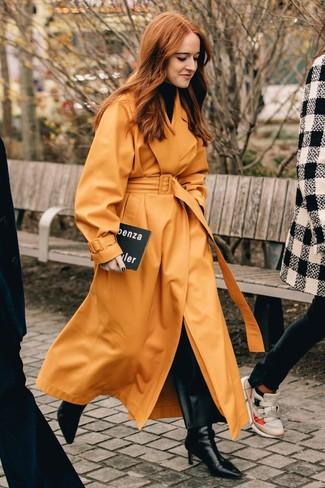 How to wear: black leather ankle boots, black leather wide leg pants, black turtleneck, orange leather trenchcoat