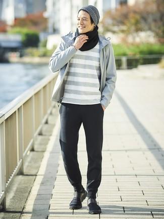 How to wear: grey windbreaker, grey horizontal striped crew-neck t-shirt, black sweatpants, black athletic shoes
