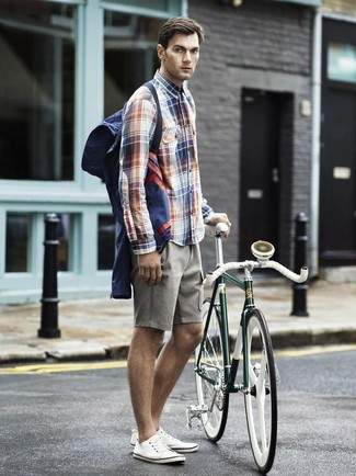 How to wear: navy windbreaker, white and red and navy plaid long sleeve shirt, grey shorts, white canvas low top sneakers