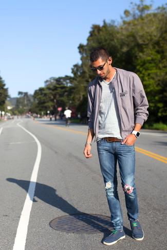 How to wear: grey windbreaker, white horizontal striped v-neck t-shirt, blue jeans, navy canvas plimsolls