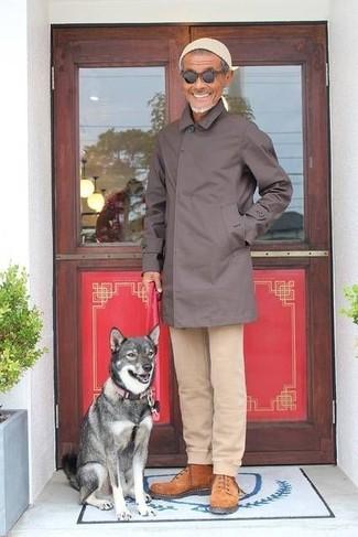 How to wear: beige beanie, tobacco suede work boots, beige chinos, dark brown raincoat