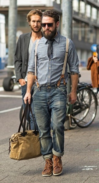 How to wear: tan canvas tote bag, brown leather work boots, blue jeans, blue vertical striped chambray long sleeve shirt