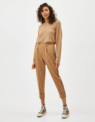 How to wear: yellow canvas high top sneakers, tan tapered pants, tan crew-neck sweater