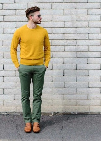 How to wear: yellow crew-neck sweater, green chinos, tan leather double monks, dark brown sunglasses