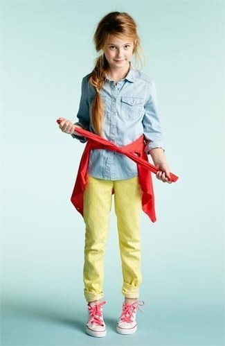 How to wear: pink sneakers, yellow jeans, light blue denim long sleeve shirt, red cardigan