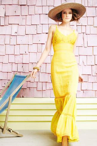 How to wear: yellow lace maxi dress, khaki straw hat
